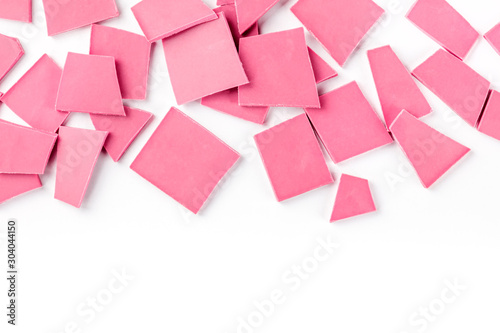 Fotografía  Ruby chocolate slices, overhead shot on a white background with a place for text