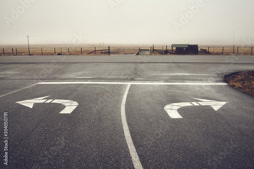 Photo Left or right, roads intersection on a rainy day, color toning applied, Wyoming, USA