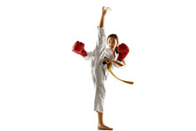 Confident Junior In Kimono Practicing Hand-to-hand Combat, Martial Arts. Young Female Fighter With Yellow Belt S Training On White Studio Background. Concept Of Healthy Lifestyle, Sport, Action.