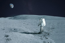 Astronaut Is Walking On The Moon. With Land On The Horizon. Elements Of This Image Were Furnished By NASA.