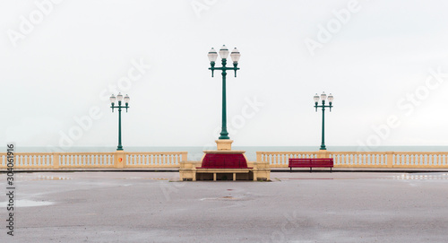 Photo Promenade over Atlantic Ocean / Sea with three street lamps and benches in Porto
