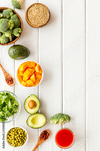 Healthy food. Vegatables and fruits on white wooden background top view frame copy space - 304062540