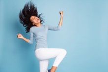 Photo Of Excited Ecstatic Overjoyed Grimacing Girlfriend Throwing Her Hair By Waving Head In White Pants Blue Sweater Rejoicing Isolated Pastel Color Background