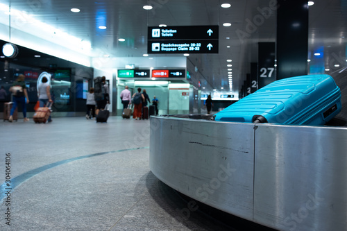 Arrived luggage going around on a conveyor belt waiting to be claimed at the bag Wallpaper Mural