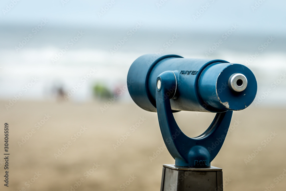 Fototapety, obrazy: Blue telescope pointed toward the ocean