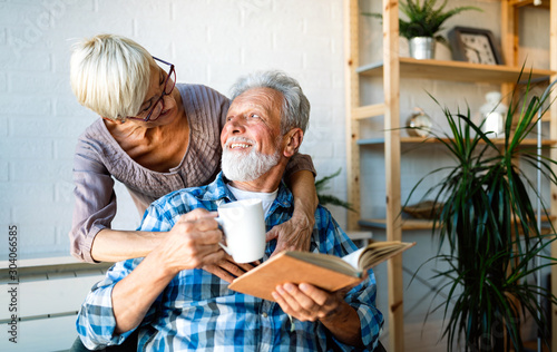 Obraz Happy romantic senior couple hugging and enjoying retirement at home - fototapety do salonu