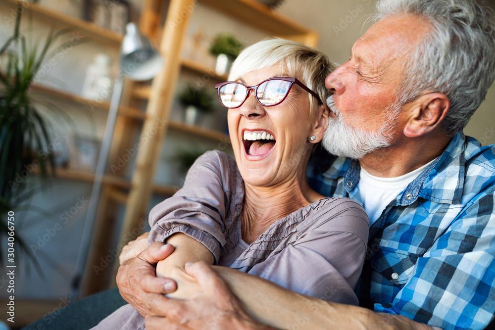 Fototapeta Cheerful senior couple enjoying life and spending time together