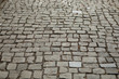 Grey ancient brick road texture background from square stones antique architecture paved footpath for walk