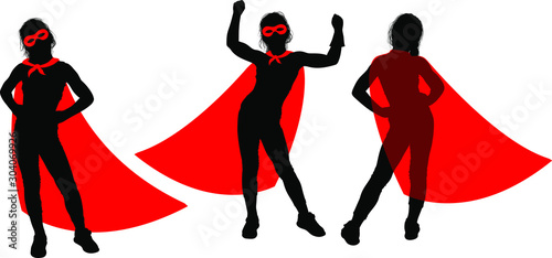 Black Silhouette of a strong superhero supergirl in a fluttering red cloak on a Poster Mural XXL