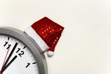 Clock With A Christmas Cap On ...