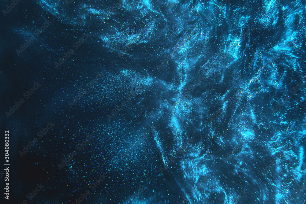 Fototapety, obrazy: Abstract elegant, detailed blue glitter particles flow with shallow depth of field underwater. Holiday magic shimmering underwater space luxury background. Festive sparkles and lights. de-focused.