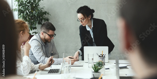 Creative people analyzing data on meeting in office