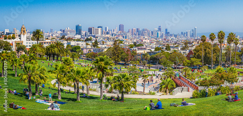 Panoramic view of local people enjoying the sunny summer weather at Mission Dolo Wallpaper Mural