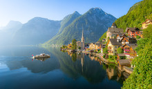 Classic Panoramic View Of Famous Old Town Hallstatt And Alpine Deep Blue Lake With Tourist Ship In Scenic Golden Morning Light On A Beautiful Sunny Day At Sunrise In Summer, Salzkammergut, Austria