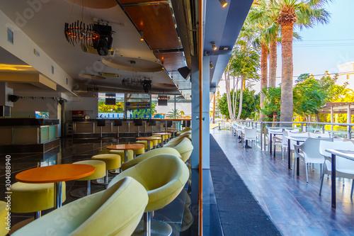 Valokuva lounge bar of modern European resort hotel, interior with terrace, tables, lighting