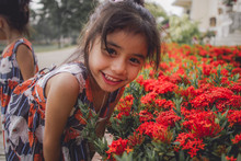 Portrait Little Girl With Red Ixora