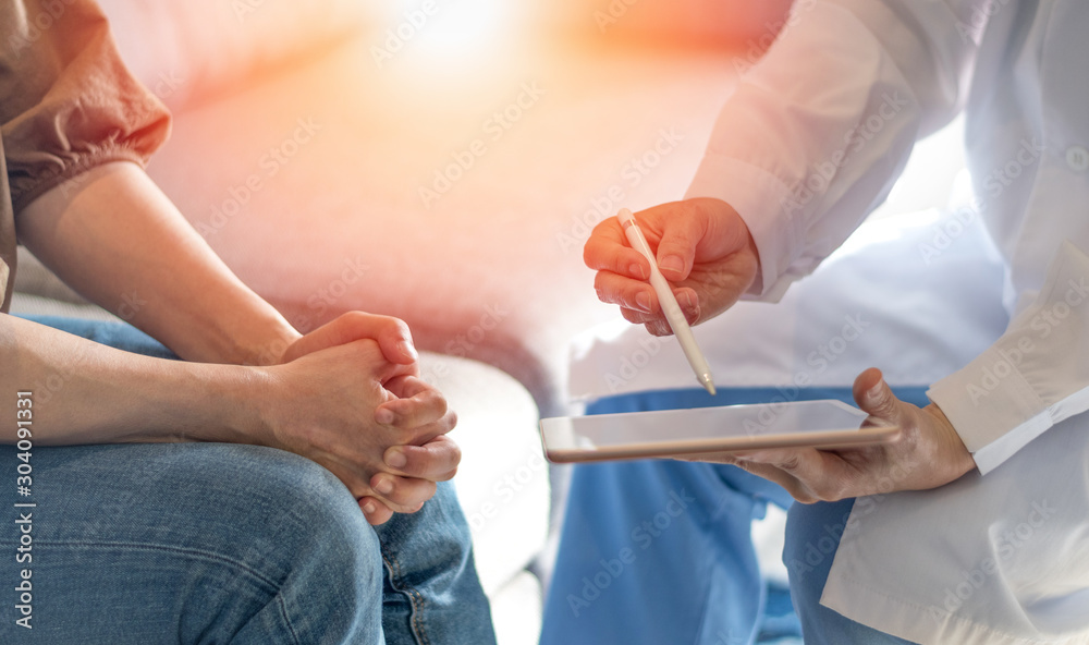 Fototapety, obrazy: Doctor and patient healthcare technology concept. Gynecologist physician consulting and examining woman patient health using computer tablet  in Obstetrics and Gynecology dept in medical hospital