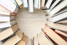 Heart Made Of Books On White Wooden Rustic Background, Top View