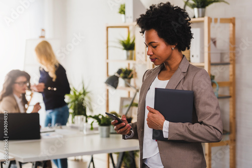 Portrait of African American Business Woman standing at Office