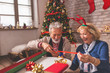 canvas print picture Senior couple wrapping Christmas gifts