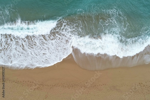 Photo  Coastline over the wave in the Mediterranean sea