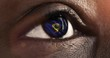 Woman black eye in close up with the flag of Vermont state in iris, united states of america with wind motion. video concept
