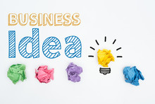 Top View Of Business Idea Inscription Near Colorful Crumpled Paper Balls On White Background, Business Concept