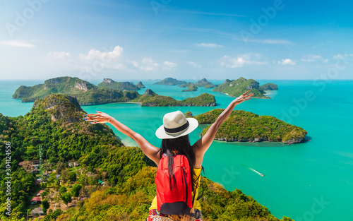 Backpack traveler woman on top group of island joy view beautiful nature scenic Fotobehang