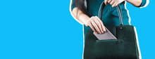 Woman Hand Phone With Bag On Gray Background