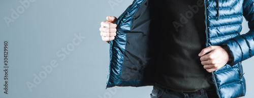 man hand jacket on gray background