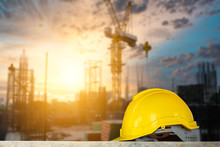 Construction Safety Concept, Yellow Hard Safety Helmet Hat In Construction Site