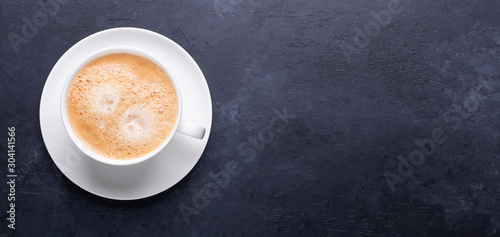 Cup of coffee on black stone background Top view Horizontal banner