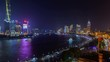 Shanghai huangpu river urban cityscape aerial skyline panorama timelapse at night zoom out