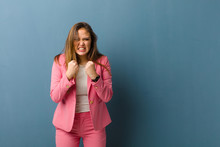 Businesswoman Shouting Aggressively With Annoyed, Frustrated, Angry Look And Tight Fists, Feeling Furious