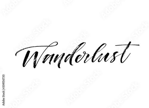Obraz Wanderlust hand drawn card. Hand drawn brush style modern calligraphy. Vector illustration of handwritten lettering.  - fototapety do salonu