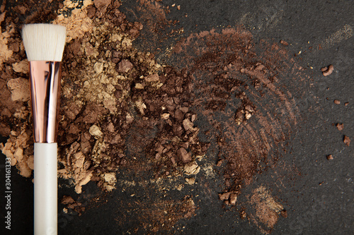 Fotografia, Obraz White make up brush and brown and gold eyeshadows arranged on flat stone