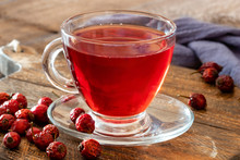A Cup Of Rose Hip Tea With Dried Rose Hips