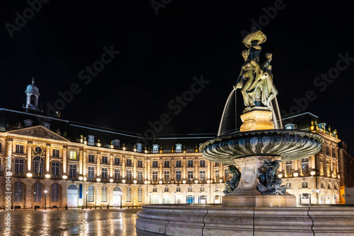 Fountain of three graces on the place de la bourse in Bordeaux at night in Giron Wallpaper Mural