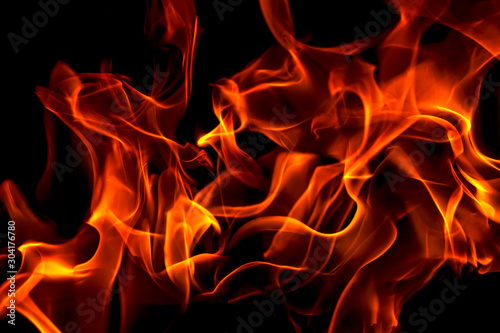 Red fire forms abstraction in black background - 304176780