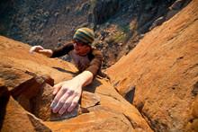 A Man, Makes Some Hard Finishing Moves On A 5.10c Trad Climb At Vantage.