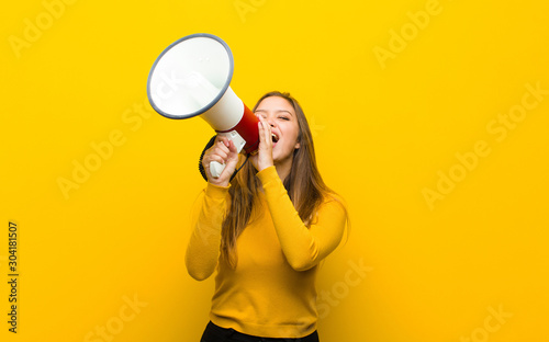 young pretty woman with a megaphone Canvas Print