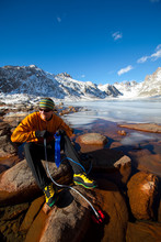 A Man Pumps Some Water Using An MSR Filter At One Of The Many Beautiful Titcomb Lakes In The Titcomb Basin Deep In The Wind River Range In Wyoming.