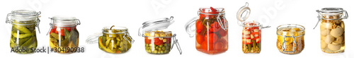Fotografia Jar with canned cucumbers on white background