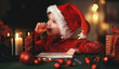 canvas print picture happy child girl writing letter santa home near Christmas tree.