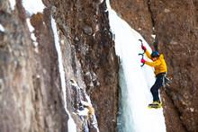 Side View Of Man Alpine Climbing