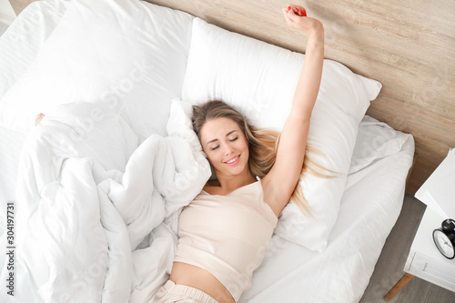Morning of sleepy young woman in bed Canvas Print