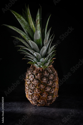 Fototapety, obrazy: still life of pineapple whole on wooden stand and pineapple cut into pieces