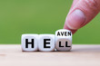 """Leinwandbild Motiv Hell or heaven? Hand turns a dice and changes the word """"hell"""" to """"heaven""""."""