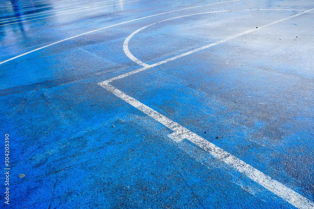 Fototapety, obrazy: Wet blue outdoor basketball court