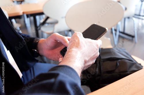 Fototapeta Man using mobile phone in cafe  obraz na płótnie